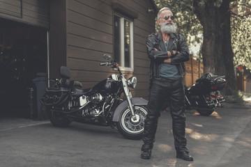 Crackerjack old man locating near motorbike