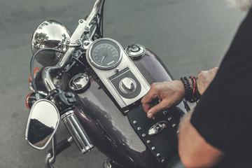 Man sitting on contemporary motorbike