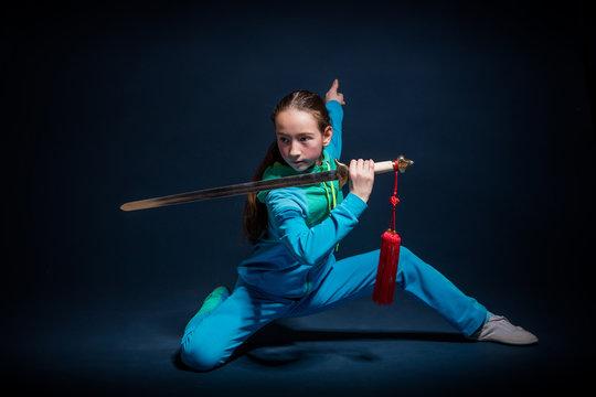 Girl in a blue wear engaged wushu