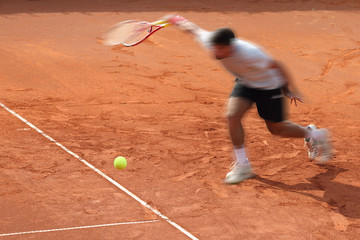 tennis court ball play and motion blur
