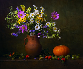 Still life with wildflowers and berries