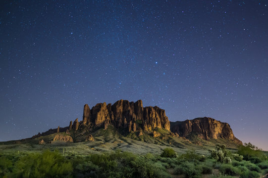 Superstition Mountains in Arizona at night under clear, starry sky