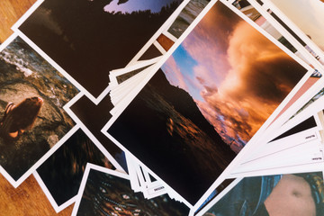 Printed photos on table