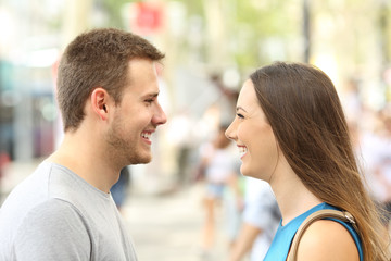 Profile of couple looking each other falling in love
