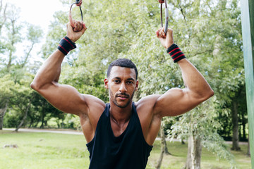 Portrait of young man exercising in park