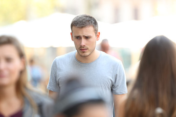 Sad boy walking on the street