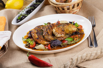 Grilled chicken with garlic and vegetables.