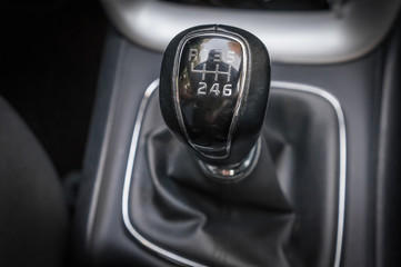 Car interior with manual shift gear transmission stick