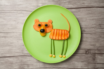 Tiger made of raw food on green plate