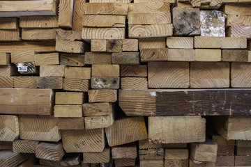 Wood stacked neatly in geometric pattern.