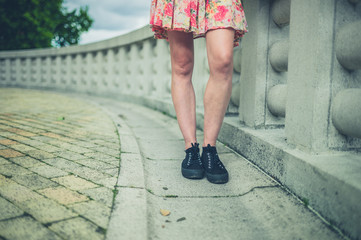 Legs of young woman by wall in city