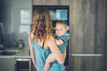 Mother with baby in kitchen