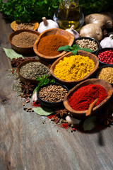 Canvas Prints Spices assortment of oriental spices on a wooden table, vertical