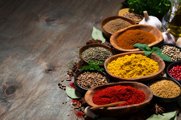 Foto op Canvas Kruiden assortment of oriental spices on a wooden background