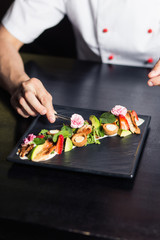 Fotobehang Sushi bar Male cook serve delicious steak on the cutting board at street cafe