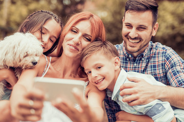 Family taking selfie with smart phone