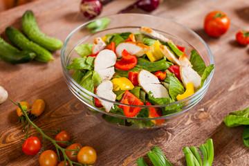 chicken salad bowl on kitchen table, balanced diet