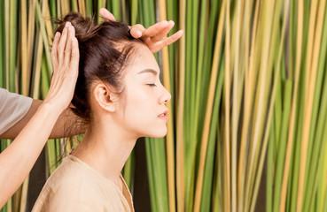 Women is having head massage relaxation on tree background