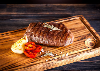 Wall Mural - Medium rare grilled Steak Ribeye on a wooden board