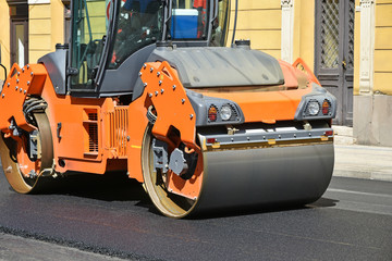 Road roller at work on the street