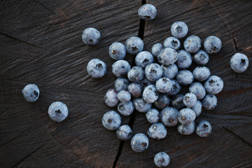 Blueberries on a dark wooden background