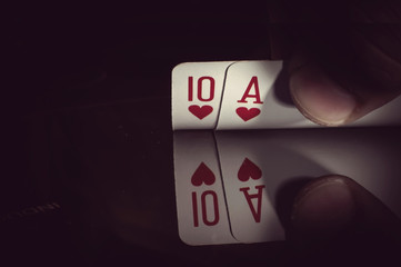 hand holding best classic winning blackjack combination ten and ace