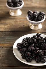 Delicious Blackberries on Rustic Table