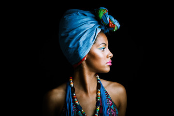 African black young woman beauty portrait with turban studio