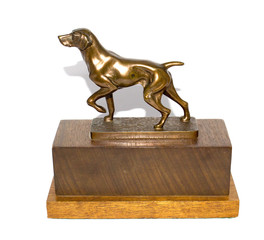 A bronze model of a working Labrador on stepped hardwood base