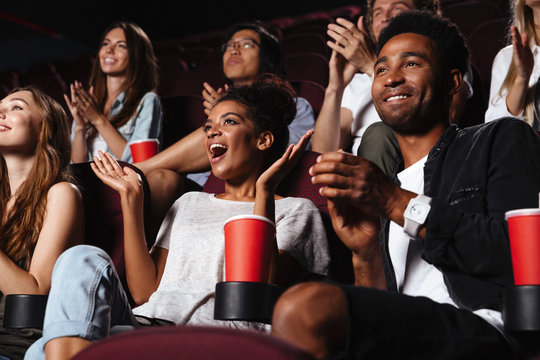 Multiethnic happy audience clapping hands