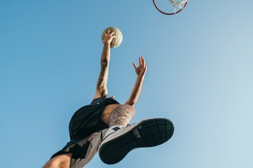 Low angle view of basketball player with basketball