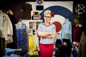 Portrait of quirky vintage mature woman in vintage clothes shop