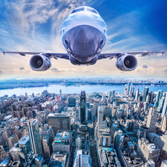 Wall Mural - airplane above new york city