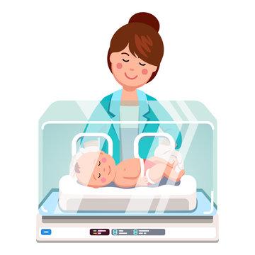 Pediatrician doctor woman examining newborn baby