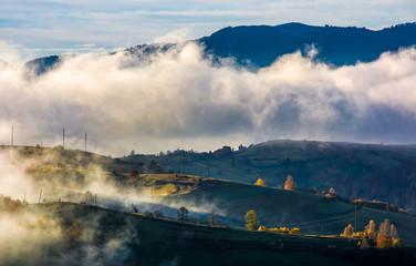 fog rising over the rural hills in morning light