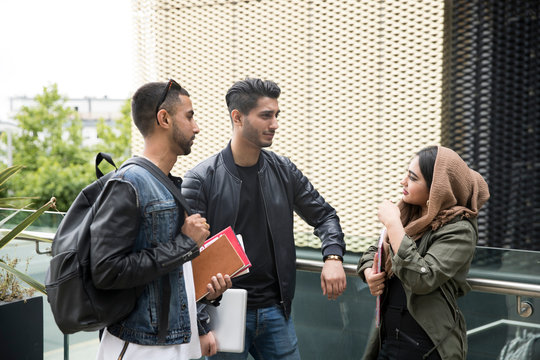 Friends outdoors, having conversation in street
