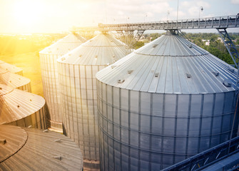 Grain storage silos. Galvanized tanks for grain. Granary with mechanical equipment for receiving, cleaning, drying, grain shipment