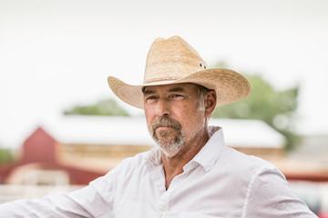Mature man in cowboy hat on ranch, Bridger, Montana, USA