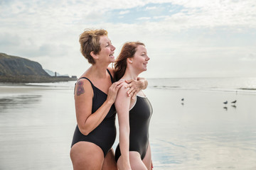 Mother and daughter on beach, Folkestone, UK