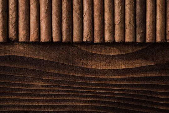 Cuban cigars close up on wooden table