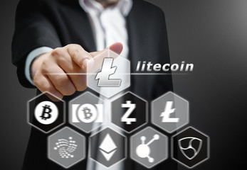 Business man points his finger at Litecoin icon, Concept of  Cryptocurrency, a digital currency