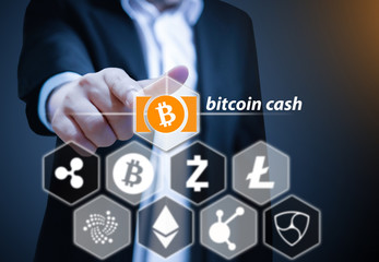 Business man points his finger at Bitcoin Cash icon, Concept of  Cryptocurrency, a digital currency