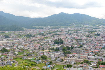Ariel view of small town with mountain in background, Shimoyoshida in Yamanashi, Japan.