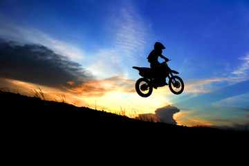 motorcycle silhouette are jumping