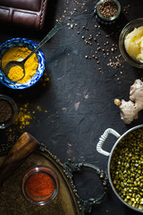 Concept of Indian cuisine with mung dal on the dark background