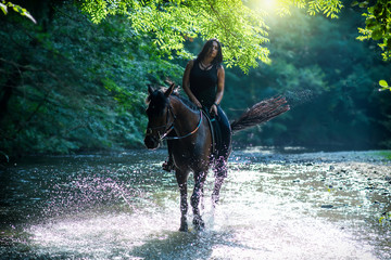 Horse riding on the river