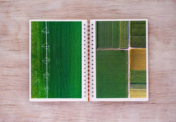 Open book with agricultural scenes