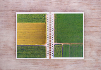 Open book with agricultural scene