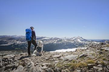 Rear view of woman hiking with dog on Jackson Peak Bridger