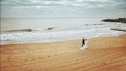 Beautiful wedding couple on a walk near water